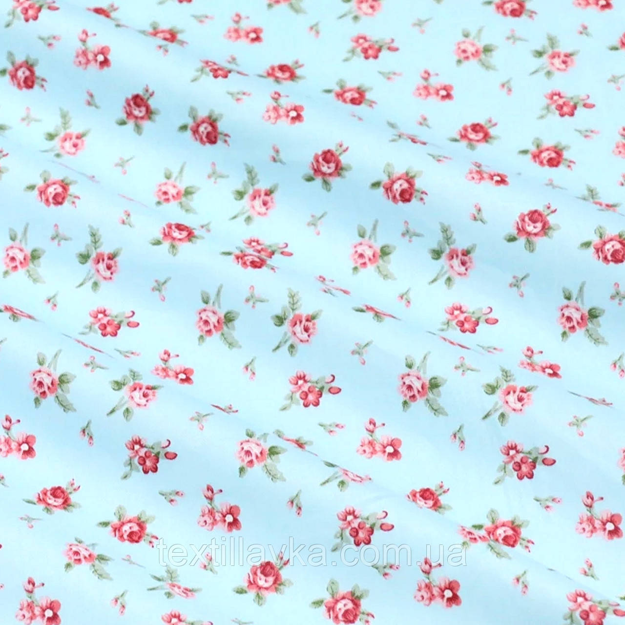 Ткань хлопок для рукоделия мелкие розочки на голубом