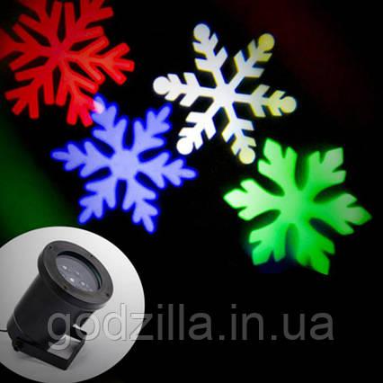 LED проектор Разноцветные снежинки