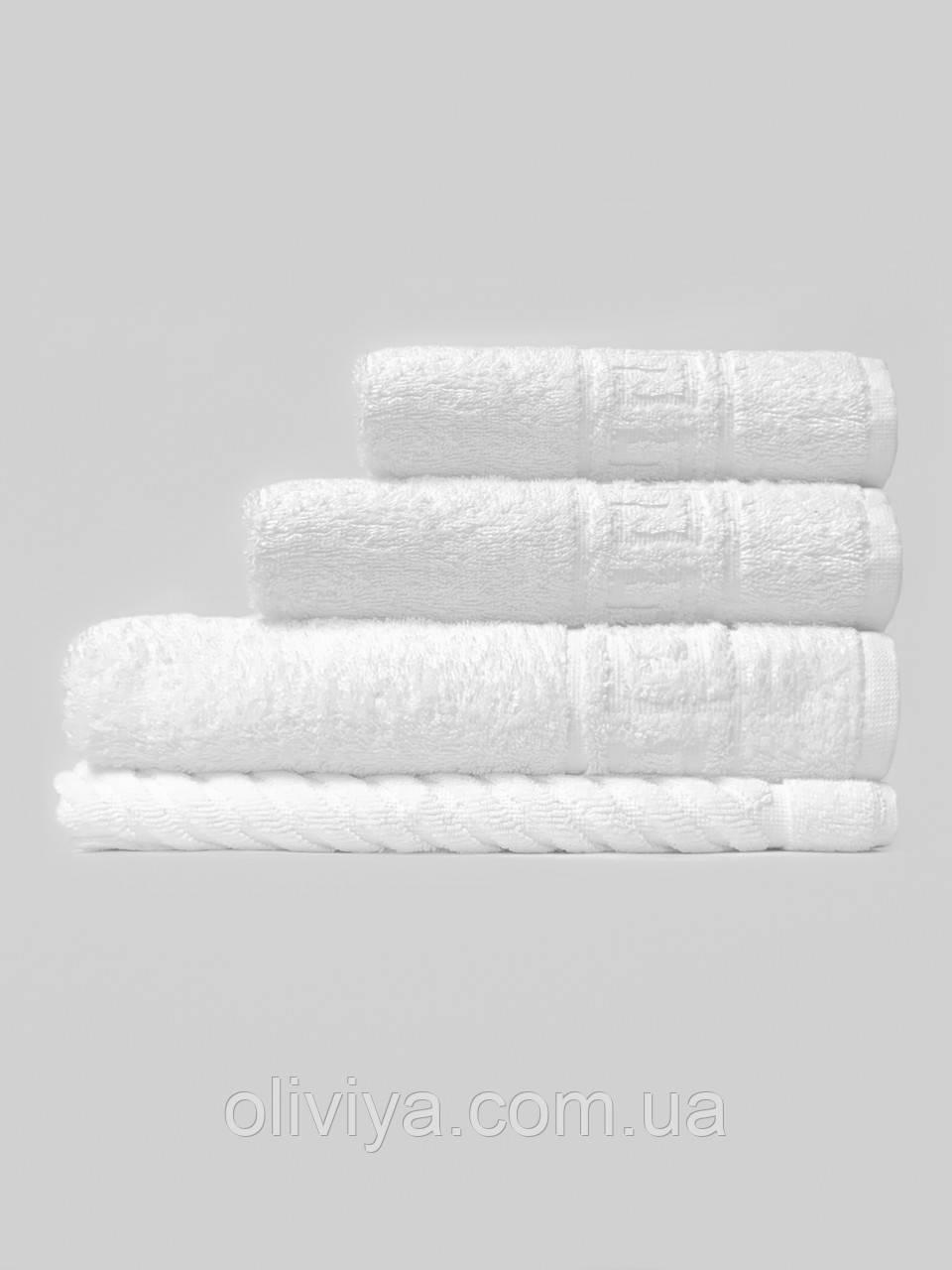Махровые полотенца для гостиниц белые