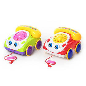 Каталка 0316 машинка-телефон,звук,2 кольори,рухає очима,показує язик,в кульку,18-17-11см