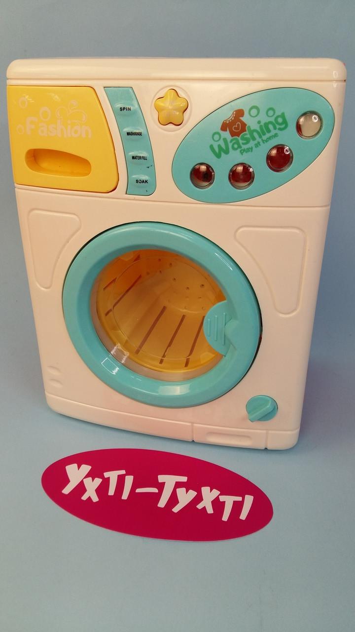 Пральна машина іграшкова, світло, звук, музика, обертається барабан, на батарейках в коробці 7914