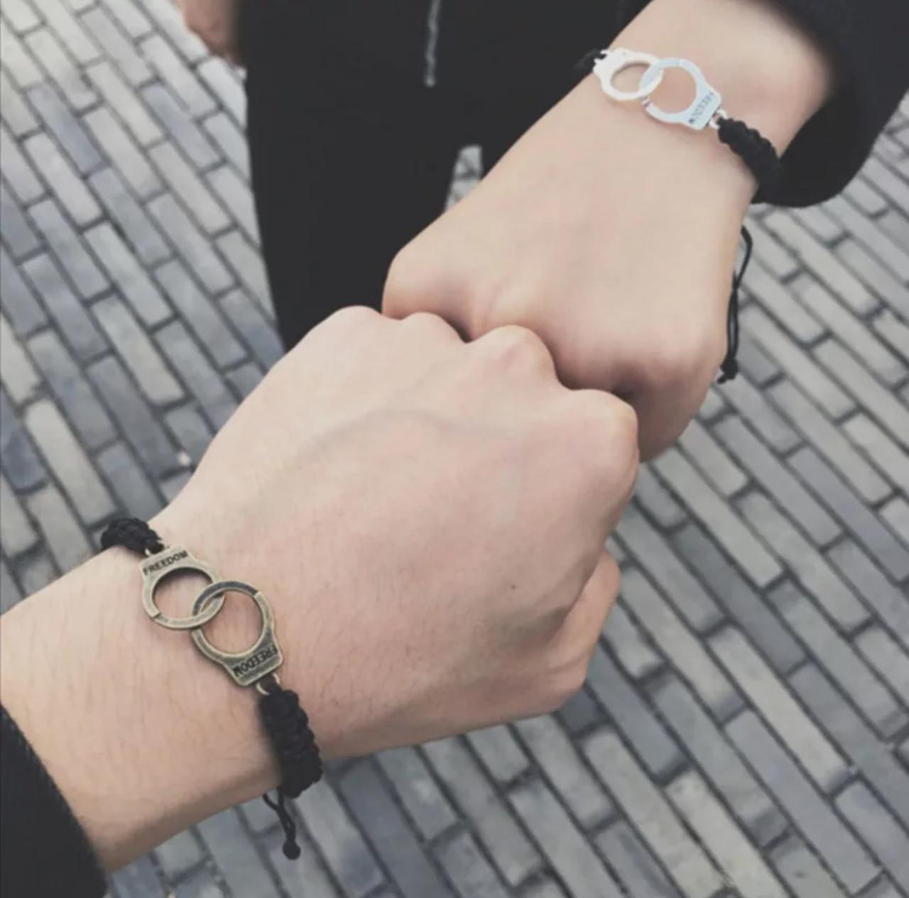 Браслет унісекс на руку наручники два кольори