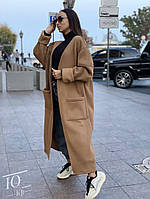 Стильне жіноче пальто з накладними кишенями