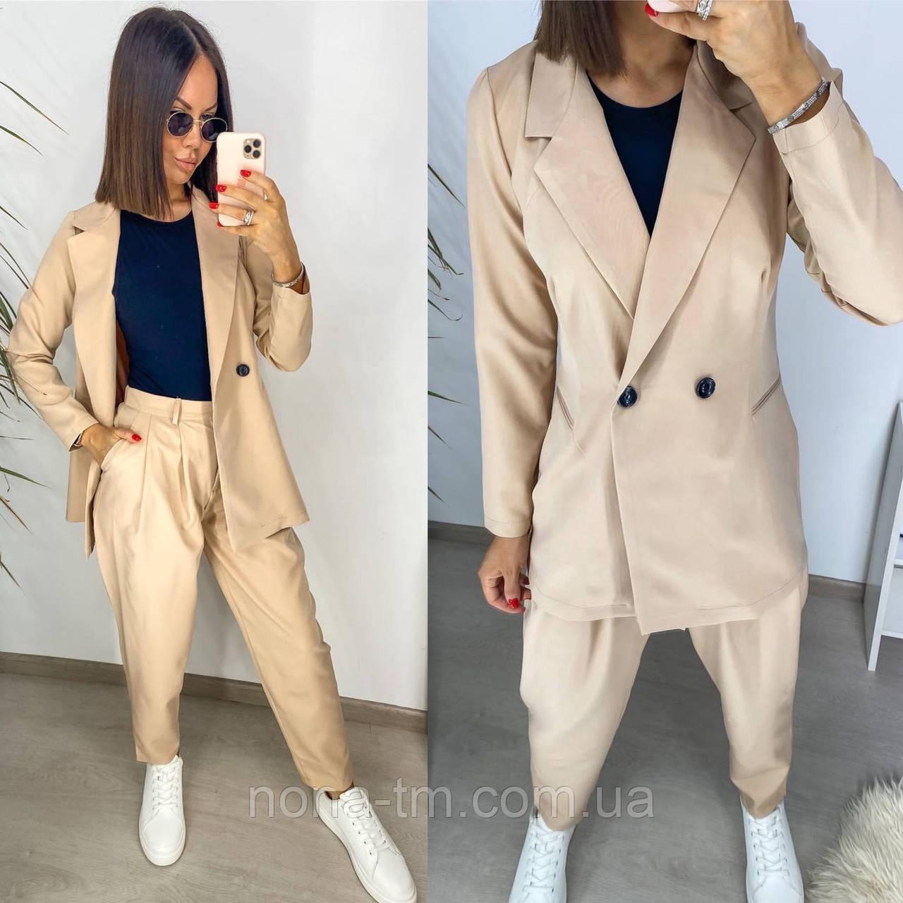 Модний костюм жіночий з жакетом і штанами