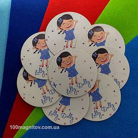 Рекламний магніт для інтернет-магазину дитячого одягу. Діаметр 68 мм 1