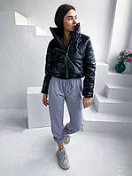 Женская короткая дутая куртка из эко-кожи с воротником стойкой