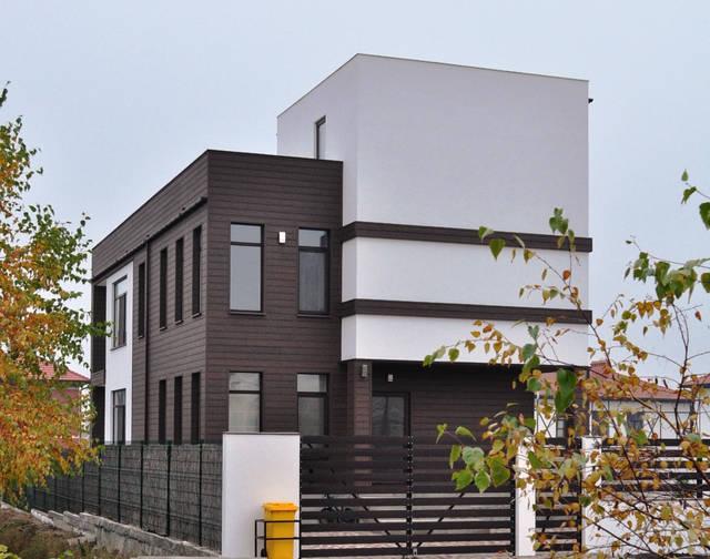 Реализован проект фасада из древесно-полимерного композита и декоративной штукатурки в Совиньоне