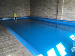 Скіммерний басейн з оздобленням терасної дошкою
