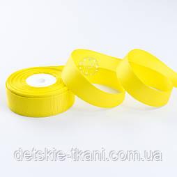 Стрічка репсова шириною 25 мм яскраво-жовтого кольору, бобіна 18 метрів