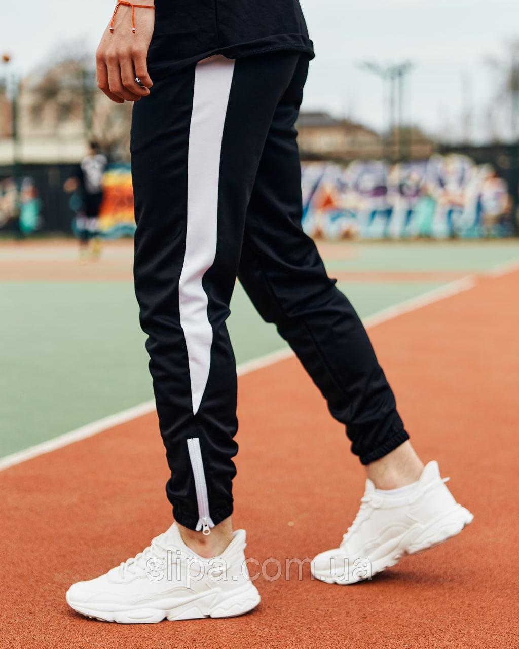 Чорні спортивні штани з білим лампасом   креп-дайвінг   унизу на блискавці