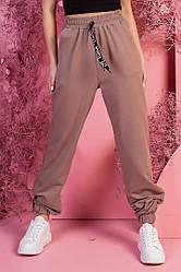 Жіночий спортивні вільні штани з кишенями, гумка у низу