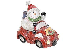 Декоративна статуетка Сніговик на машині з LED-підсвіткою, 18см, колір - червоний BonaDi 711-394