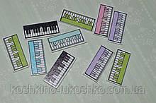 Пуговица деревянная  синтезатор