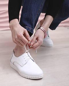 Білі шкіряні кеди без підкладали на шнурках