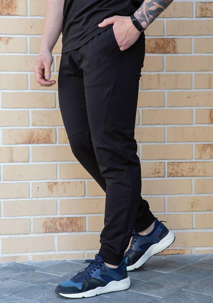Чоловічі спортивні штани джоггеры з бавовни на манжетах з кишенями колір чорний демисезон