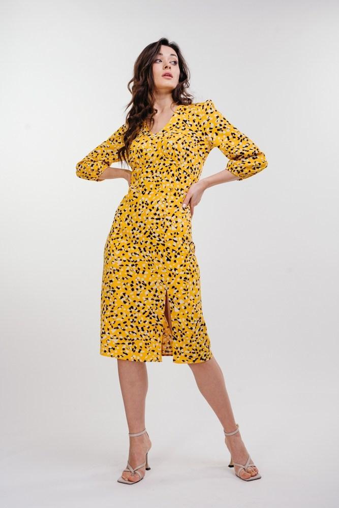 Жіноче плаття міді з розрізом