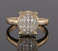 Интересное кольцо с фианитами, покрытое золотом (129490)