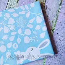 Ткань хлопок для рукоделия цветочки и зайчики на голубом фоне