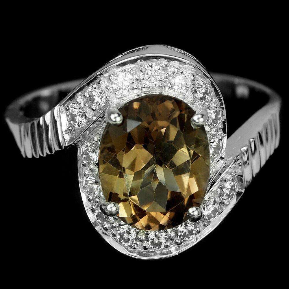 Серебряное кольцо с топазом Империал, 1689КТ