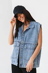 Стильна джинсова жилетка в блакитному кольорі з кишенями в 2 розмірах: S/M, M/L.