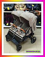Детская прогулочная коляска для двойни CARRELLO Connect CRL-5502 бежевая + дождевик Коляска для двоих детей