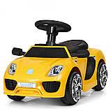 Детский электромобиль-толокар 2 в 1 с ручкой и кожаным сиденьем Porsche  M 3592L желтый, фото 5