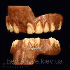 Зубні протези MOONSTRUCK CALADRIUS TEETH