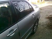 Стекло задней левой двери Mitsubishi Lancer IX
