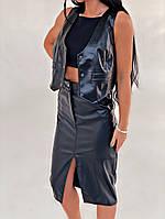 Жіноча стильна спідниця з еко-шкіри з розрізом, фото 1