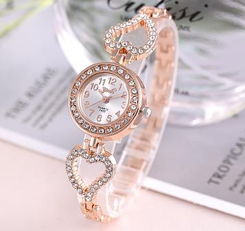 Жіночі годинники з золотистим браслетом код 651