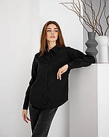 Черная блузапрямого силуэта с приспущенной линией плеча