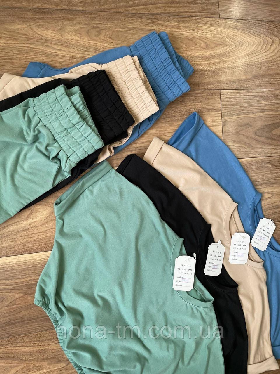 Костюм спортивний жіночий з укороченим топом і штанами