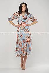 Стильное яркое удлиненное платье,цвет голубой.