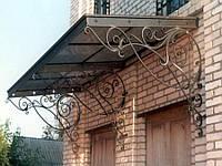 Кованые навесы и козырьки над крыльцом дома