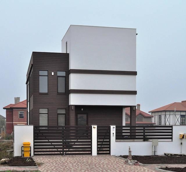 Реализован проект фасада из древесно-полимерного композита и декоративной штукатурки в Совиньоне 3