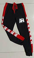 Детские спортивные штаны на манжетахдля мальчика A4 размер 4-8 лет, цвет черный с красным