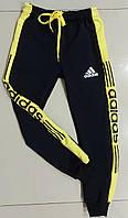 Детские спортивные штаны на манжетахдля мальчика Adidas размер 4-8 лет, цвет черный с желтым
