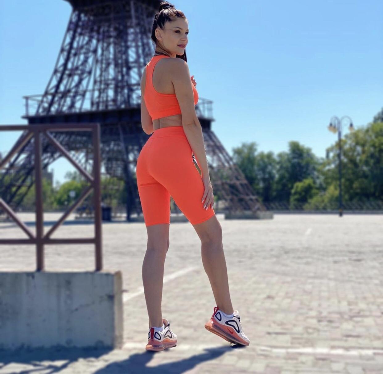 Костюм для фитнеса топ и велосипедки оранжевый