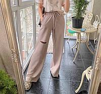 Женские стильные брюки клеш с разрезами, фото 1