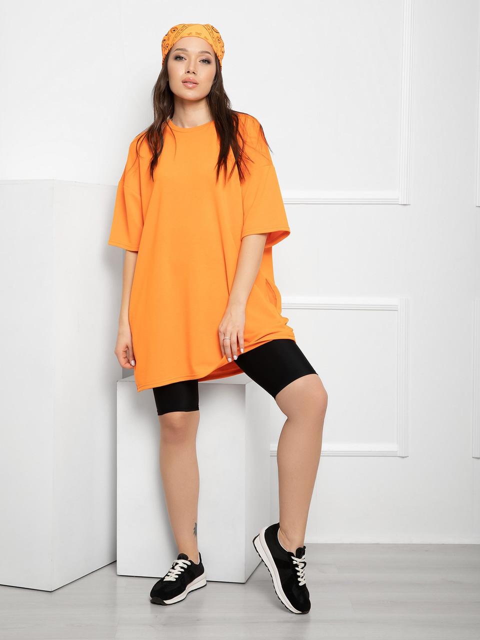 Оранжева вільна футболка трикотажна