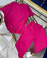 Женский стильный костюм: топ и штаны с разрезом, фото 1