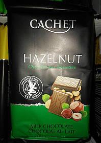 Бельгійський молочний шоколад Cachet лісовий горіх 32% какао 300 г.