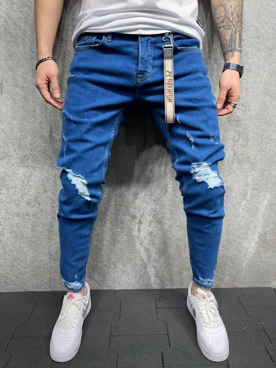Мужские зауженные джинсы синего цвета рваные