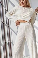 Белый спортивный костюм состоит из джемпера и брюки палаццо 42-46, 48-52