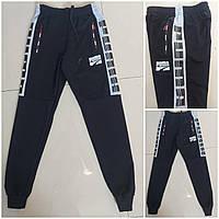 Подростковые спортивные штаны на манжетахдля мальчика Puma размер 12-16лет, цвет черный с серым