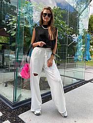Костюм женский: топ с подплечниками и штаны широкие с разрезами (в расцветках)