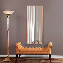 Зеркало в тонкой раме оранжевого цвета