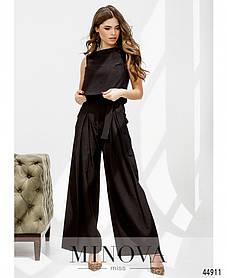 Моднячий женский костюм с укороченной майкой и брюками клеш, черного цвета размер 42, 44, 46, 48