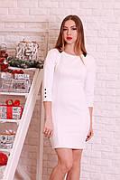 Стильное трикотажное  платье прямого силуэта с кожаными вставками.