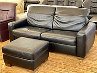 Кожаный раскладной чёрный диван с ортопедическим матрасом и пуфом